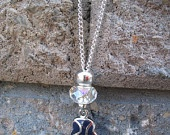 Side cross blue evil eye silver colored necklace. $14.00, via Etsy.