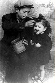 A Child Feeding his Sister, Lodz Ghetto, Poland.