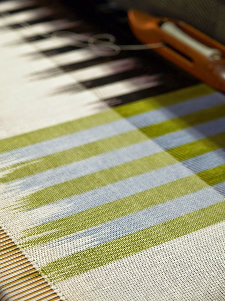 Andrea Donnelly ....hand stitched ends to secure fringe...painted warp