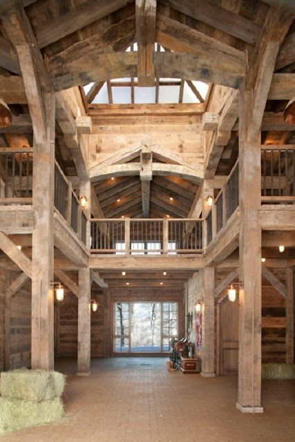 Beautiful, open barn. Could have a lobby, break room, bunkhouse, and bathrooms upstairs. Horses, tack, feed, and hay downstairs. The upper could also look out into the arena as a second level, and include an announcers' stand.