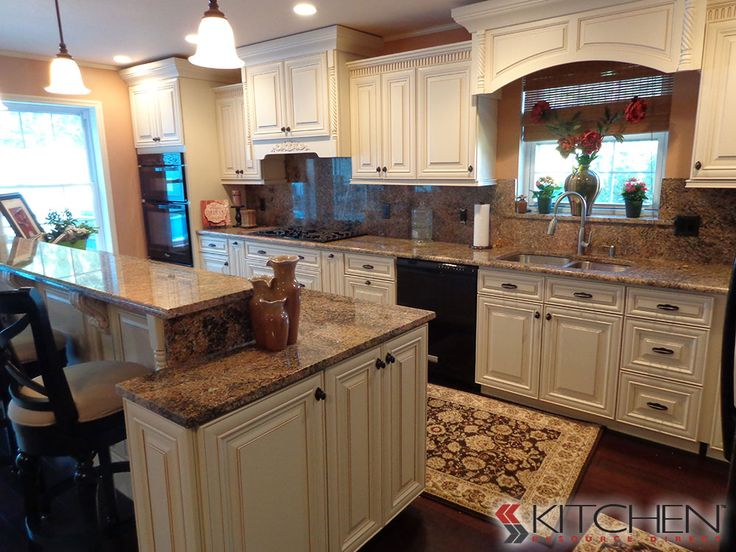 """Traditional kitchen with staggered height kitchen counter; 42"""" H at eating area, 36"""" H at food prep area"""