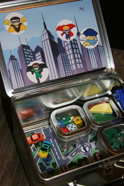 Kids travel kit: no small pieces, applesauce in a pouch and similar no-mess snacks, play doh, triangular crayons (don't roll), books, small gifts to unwrap for good behavior, etc., and lollipops for take off and landing (helps with pressure changes)