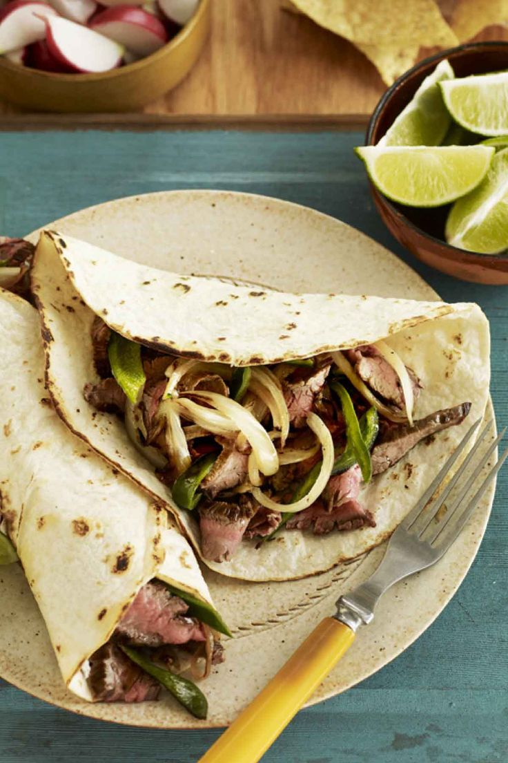 Flank Steak Fajitas  - CountryLiving.com