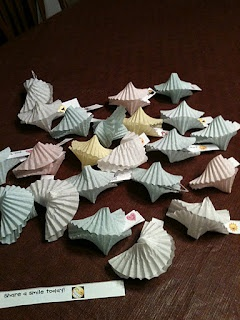 paper muffin cups made into Chinese fortune cookies - site includes free download of strips to put into them.