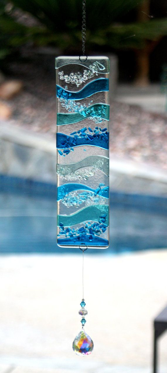 Custom Fused Glass Panel. 7 tall x 22 wide. Waves going horizontally in Caribbean Blue, Sky Blue, Deep Aqua, and Blue Topaz. Cost of panel will