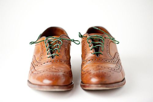 Brown leather brogues with green laces