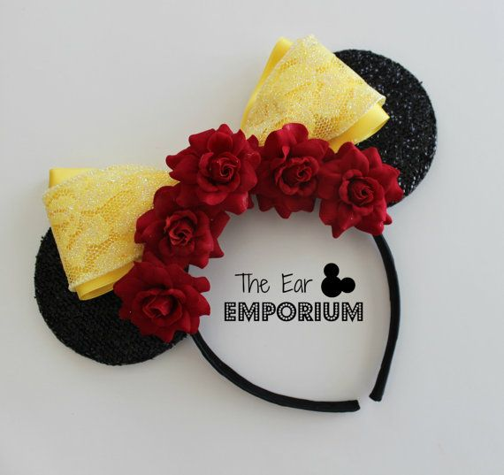 """READY TO SHIP ~ all ears are created and listed for immediate shipping! Tale as old as time... These red rose and yellow sparkle ears are perfect for a day in the Disney parks!  Satin and sparkle ribbons with red rose flowers complete this set of ears for a FUN, lightweight look.  Each headband fits both children and adults. The headbands are NOT oversized and meant to be a lightweight option. Headbands measure approximately 8-9"""" across, 8"""" tall, and 3.5"""" in diameter ears. If you have any…"""