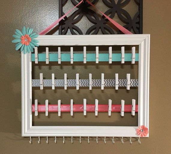 Frame Color: white Frame Size: 10x13  Ribbons with mini clothes pins are perfect to clip elastic headbands  100% customizable! This means you choose the ribbon colors/theme you would like.  This holder can hold more than just headbands. Great for pictures, jewelry, and notes!  Please note: some ribbon choices and flowers are limited on quantities. But I like to make each creation unique and not make the same holder twice.  Once I receive an order, I like to work on them and ship as soon as po...