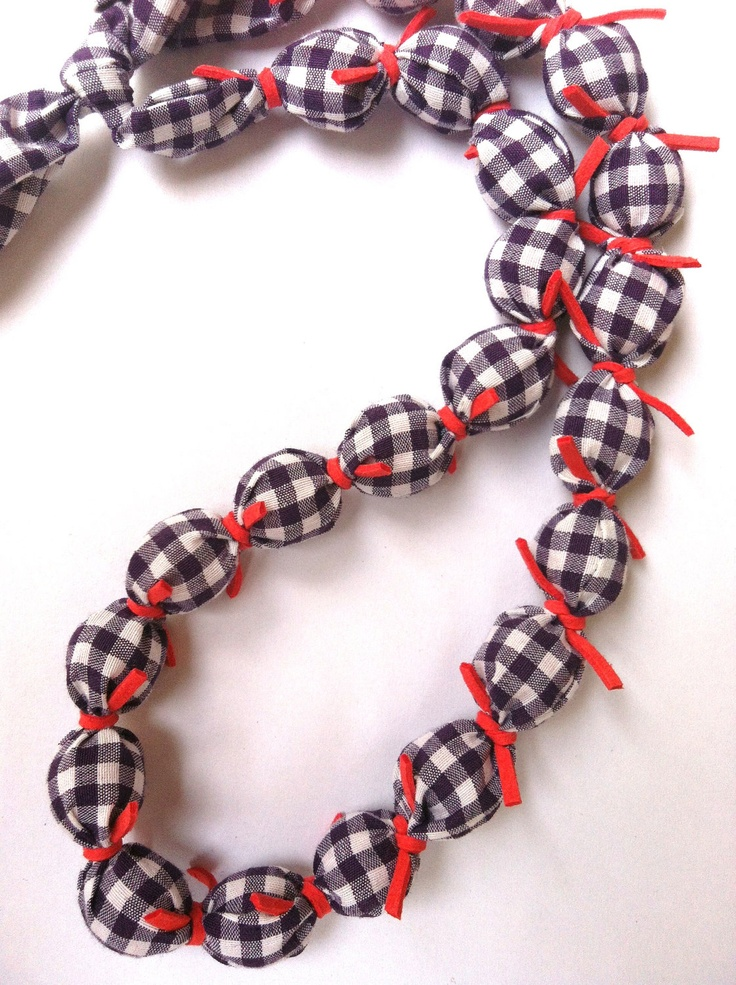 Fabric Necklace in purple and salmon colors (made to order). $32.00, via Etsy.