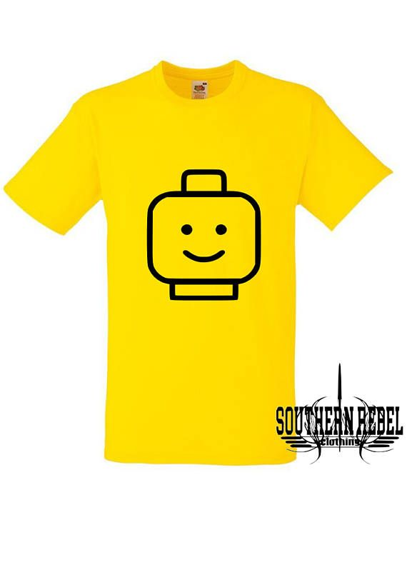 lego man t-shirt, lego t-shirt, lego mini figure, adult lego t-shirt, lego for adults, lego image, lego minifigure, minifigure t-shirt, lego face, lego transfer top, lego min figure head, kids lego top, kids lego Welcome to Southern Rebel Clothing. Home to all your Heat Transfer Vinyl designs, pressed onto top quality Fruit the Loom products of your choice, available in a wide range of colours & sizes. Here is a great Lego inspired t-shirt design. Yellow T-shirt with Black design. Ava...