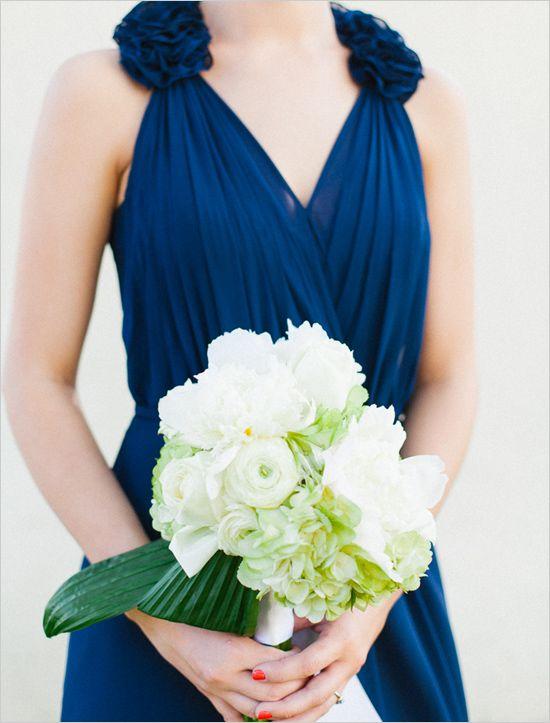 blue bridesmaid dress with white wedding bouquet by Atmore Flower Shop http://www.weddingchicks.com/2013/10/09/elegant-southern-wedding/