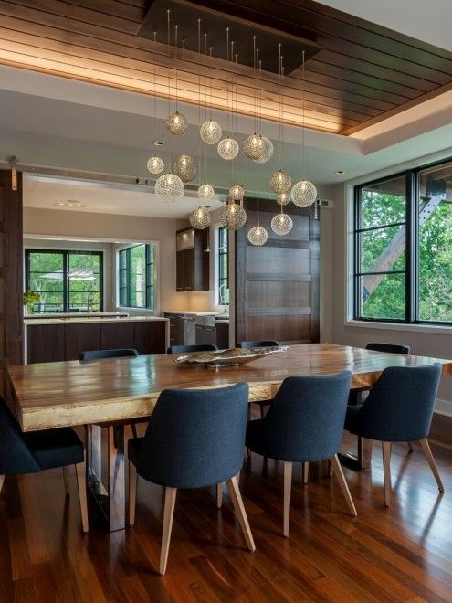 Dining room ideas. Love the chairs and the light fitting - needs some light walls to balance the look though.