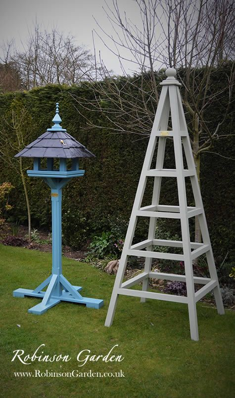A beautiful and bespoke wooden bird table, bird feeder hand crafted and hand painted in Lincolnshire, England by Robinson Garden. Visit our website for more details.