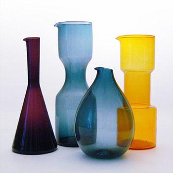 Three jugs designed by Kjell Blomberg for Gullaskruf and a yellow jug by Bo Borgström for Aseda