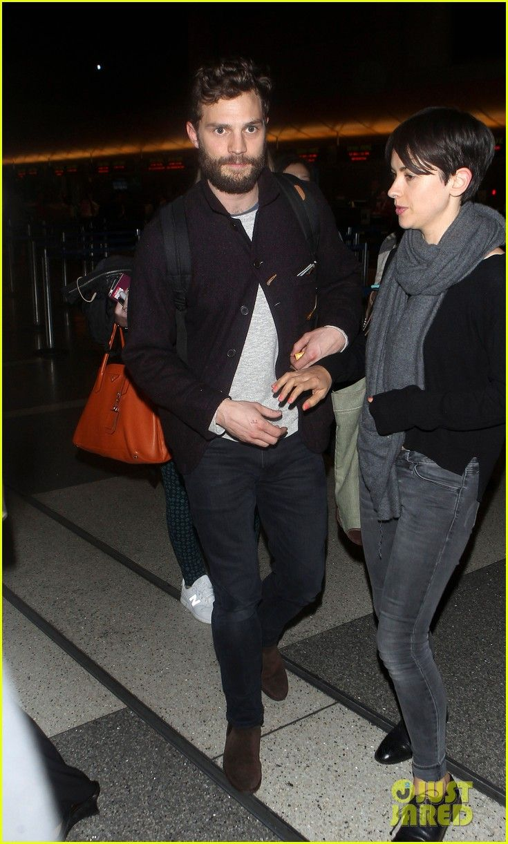 Jamie Dornan is joined by his wife Amelia Warner while making his way through a sea of fans at LAX Airport on Tuesday night (January 13, 2015) in Los Angeles.The 32-year-old Fifty Shades of Grey actor is headed out of town after attending the Golden Globes this weekend.