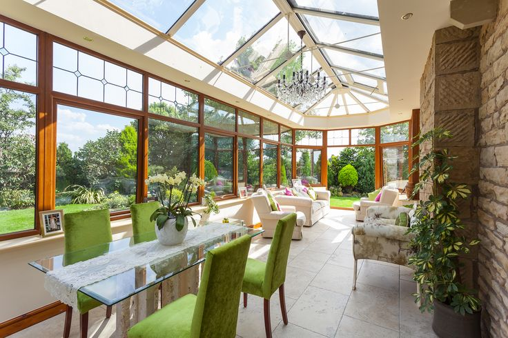 A conservatory used for dining and relaxing