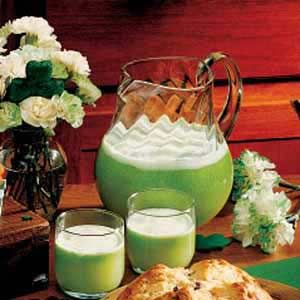 Lucky Leprechaun Lime Punch  5-3/4 cups refrigerated citrus punch  2 cans (12 ounces each) frozen limeade concentrate, thawed  1/4 cup sugar  1/4 cup lime juice  1 quart lime sherbet, softened  2 liters lemon-lime soda, chilled  5 drops green food coloring  Lime slices