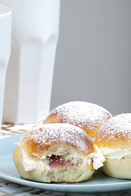 Finnish Laskiaispulla is a cardamom bun filled with whipped cream and strawberry jam or almond marzipan cream