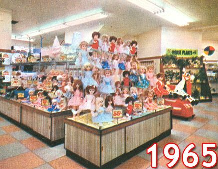 A new look Woolworth toy department with a spectacular display of dolls photographed in full colour. The shot shows the Gallowtree Gate bran...