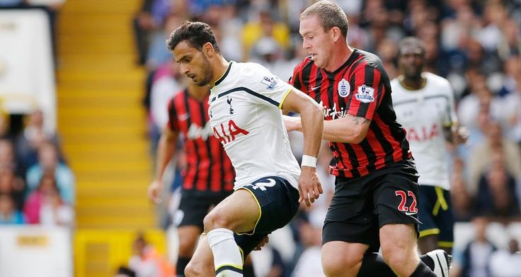 Nacer Chadli holds off Richard Dunne