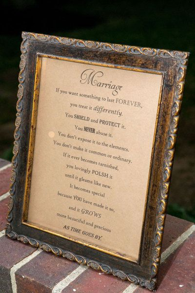 Love this idea of framing sayings about love and marriage and placing them around the reception