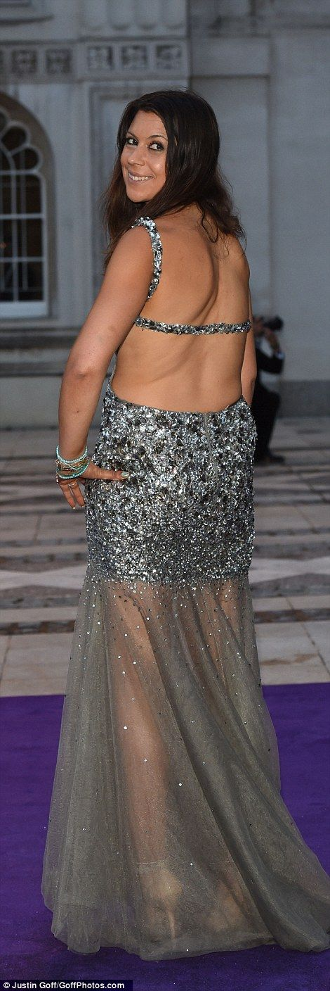 Wimbledon championMarion Bartoli sparkles in a backless silver sequinned number as she po...