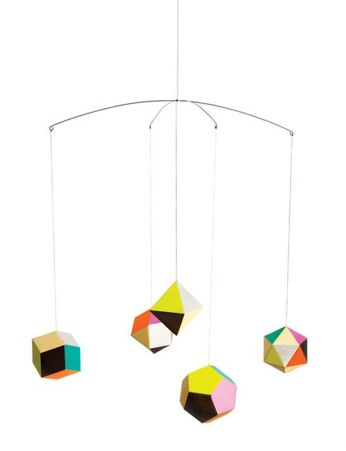 Themis Prism Mobile by Clara von Zweigbergk for Artecnica: Perfect for children and adults and especially over a crib or changing table. 5 different geometric shapes of folded paper, hanging from a delicate metal cross wire.  #Mobile #Themis_Prism #Clara_von_Zweigbergk