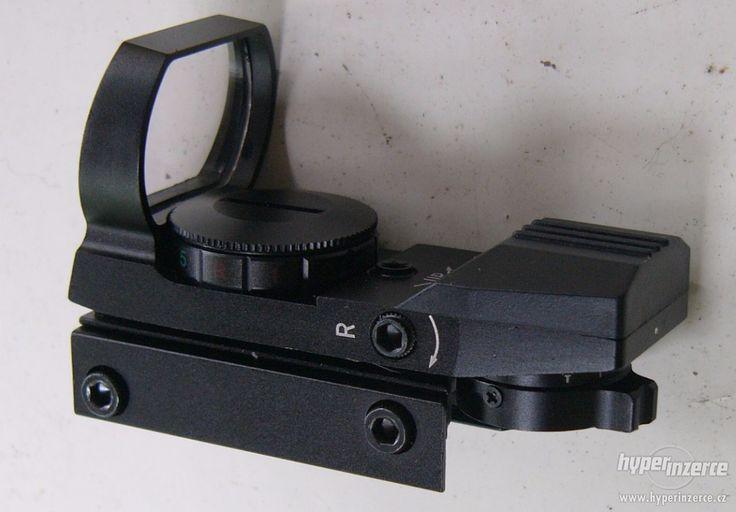 Otevřený kolimátor montáž 21 mm kovový - Nové. Celokovový otevřený kolimátor z hliníkové slitiny,s výškovou i stranovou regulací bodu. Čočka s antireflexní úpravou. Součástí dodávky krytka optiky + napájecí článek. Rozměr: délka 85 mm , šířka 36 mm , výška 65 mm Objektiv: 32×21 mm Barva světelného zaměřovače : přepínání červená - zelená v 5 stupních jasu Tvar zaměřovače: tečka , křížek , tečka v kroužku , tečka v křížkokroužku Napájení: 1×3V lithium baterie Montáž: na 21 mm rybinu Celková…