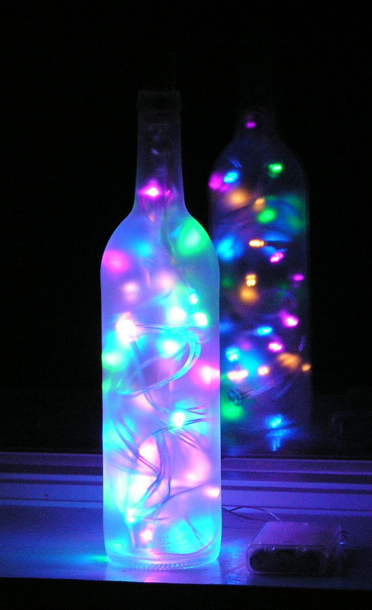 Crafts with Wine Bottles | Frosted Wine Bottle Light with multi-colored pastel LED lights inside ...