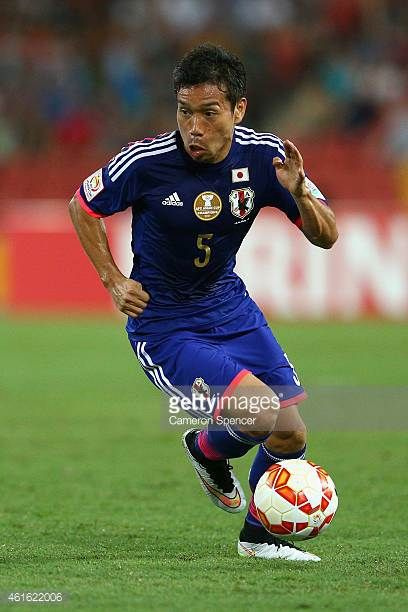Yuto Nagatomo of Japan dribbles the ball during the 2015 Asian Cup match between Iraq and Japan at Suncorp Stadium on January 16 2015 in Brisbane...