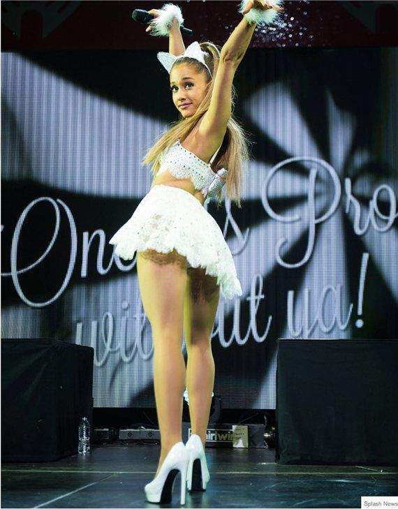 Choose from black or white on the drop down menu. Pretty angelic cat ears made from see through lace, stitched over millinery wire to stand up. These are attached to a satin ribbon covered headband. Height about 7cm or 2 3/4. The final photo is of stunning Ariana Grande, who chose the white version, seen wearing them as part of her costume, on stage at Jingle Bell Ball 2014.  Check out my other ears headbands…