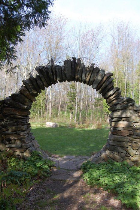 A stone moongate. It looks like this was made the old-fashioned way by carefully fitting the stones together, using clever engineering rather than mortar to reinforce the structure. Tags: moongate beauty trees design engineering architecture stone masonry mysterious