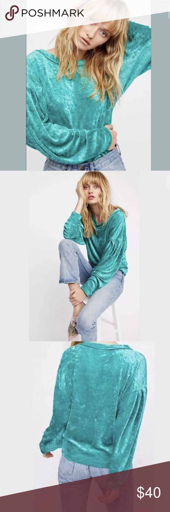 Free People We the Free Milan Crushed Velvet Oversized, could fit up to a size large depending on how slouchy you wanted to wear it. The purple top is shown to see the pleating detail in the sleeve, the top for sale is sea green.  Comfy pullover featured in a luxe velvet with dolman style sleeves.  Pleat detailing on the sleeves Rounded neckline We The Free  Perfectly distressed, all-American styles. We The Free is an exclusive, in-house label.  Measurements for size small  Bust: 37 in…