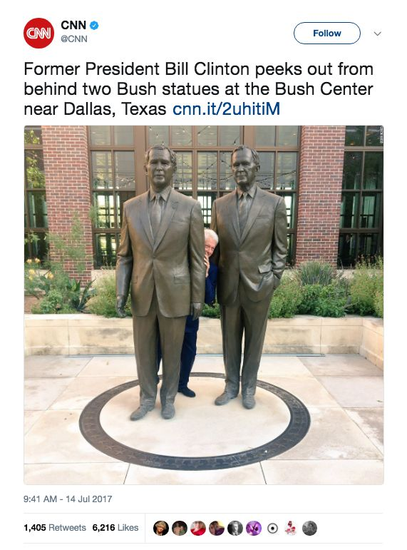 I'm Kind Of In Love With This Photo Of Bill Clinton Between Two George Bush Statues