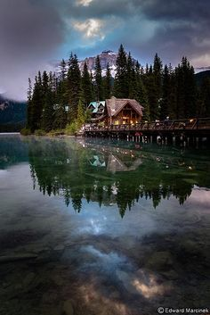 Emerald Lake, Yoho National Park, Canada. Emerald Lake is the largest of Yoho's 61 lakes and ponds, as well as one of the park's premier tourist attractions. Emerald Lake Lodge, a high-end lodge perched on the edge of the lake, provides local accommodation. A 3.2 mile hiking trail circuits the lake, the first half of which is accessible to wheelchairs and strollers. During the summer months, canoe rentals are available; in the winter, the lake is a popular cross country skiing destination.