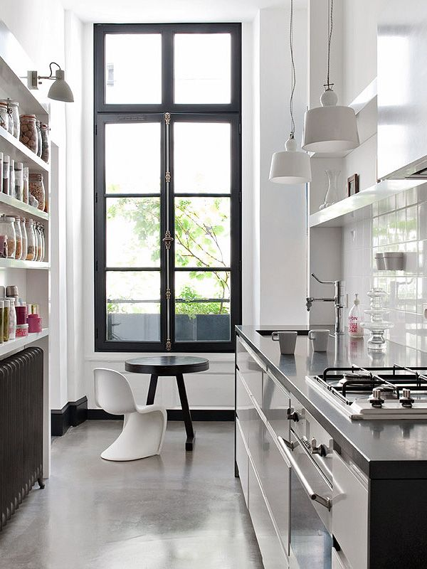 White/Black Galley Kitchen of Anne Geistorfer's Paris home. Pretty sure I'm in love with that open shelf pantry display (and everything else!)