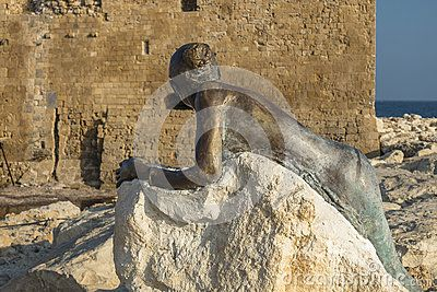Monument of the women on the shores of the the Mediterranean Sea in Pafos and the wall of the Castle. Cyprus