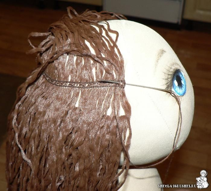 Sewn on doll hair, row by row.  Not in English but easy to follow pics and easy to translate.