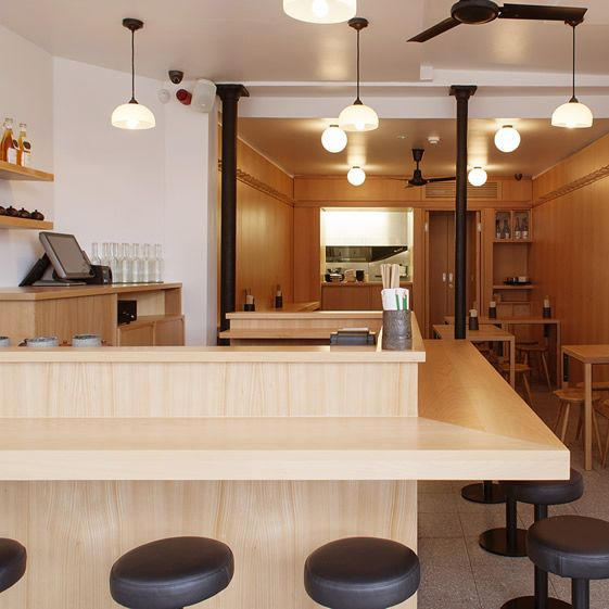 Shing, who holds an MFA from the Royal College of Art, collaborated with architects Royffe/Flynn on the compact space. Like the buns, it's all wonderfully simple. A ceramic tiled floor unites two distinct areas, with a fit-out of attractive wooden panelling to the rear and a lighter counter-bar arrangement up front...