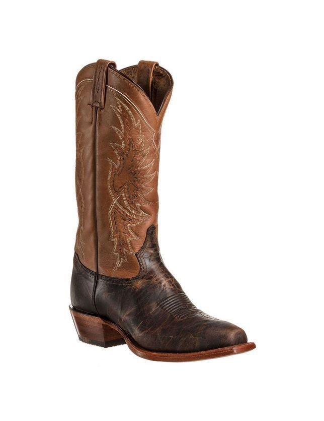 TONY LAMA CE 4062 TAN BOTTES COUNTRY POUR HOMME Vous allez adorer le contraste entre le cuir vielli chaleureux de l'empeigne et le cuir fauve rebrodé de la tige de cette botte. Fabriquées à la main aux Etats Unis, les bottes Tony Lama font partie des bottes de cow boy les plus renommées pour leur qualité de fabrication et leur confort. Les pointures indiquées sont des tailles américaines, vous pouvez consulter le guide des tailles pour choisir la pointure qui vous convient.