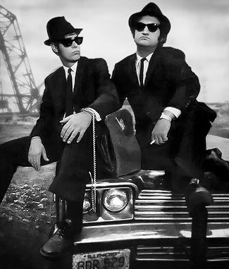 """Jake & Elwood/ Blues Brothers---""""It's 106 miles to Chicago. We got a tank full of gas, half a pack of cigs; it's dark and we're wearin' sunglasses.""""  """"Hit it!"""""""