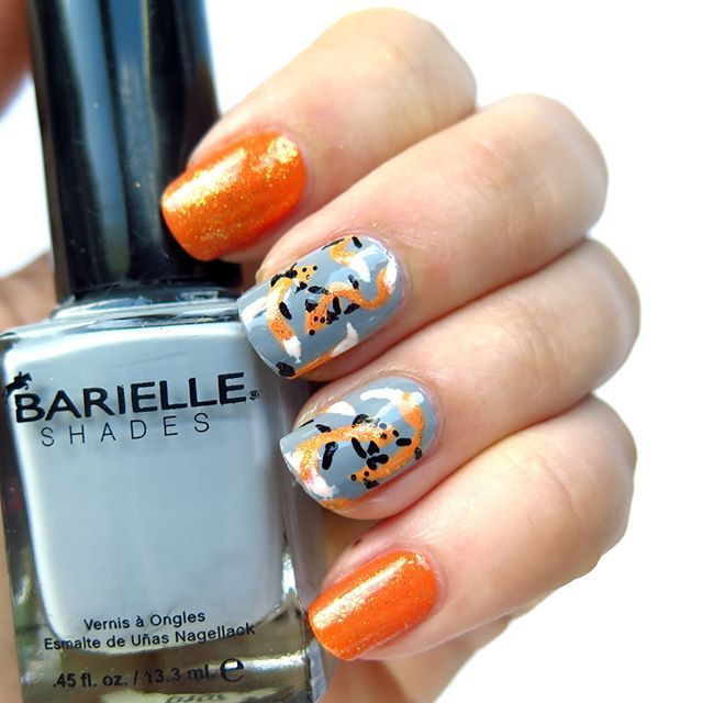 #31DC2016 challenge day 2 #orangenails  as you probably know, I love foxes so the theme for today's nail art was obvious. I've created this crazy foxy pattern   over gray nailpolish @barielle #uconcreteme. Sparkly golden effect was achived by @goldenrosepolska glittery nailpolish from Paris series. How do You like this? Follow #31DC2016theCieniu   Videotutorial on YT ➡️link in bio⬅️