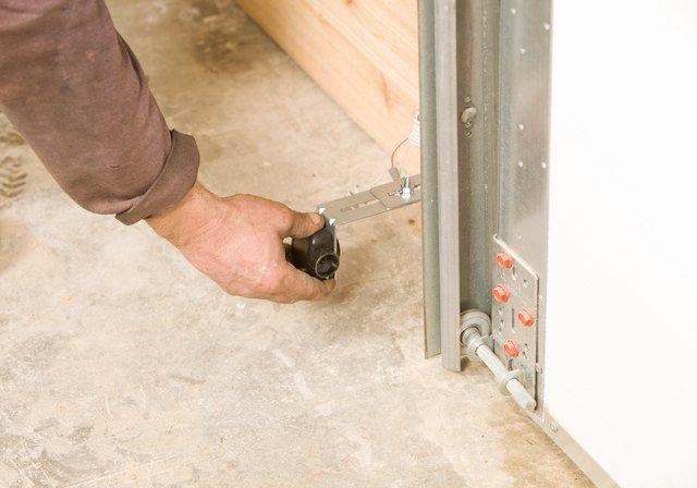 Programming And Troubleshooting Craftsman Garage Doors And Openers Hunker Garage Door Sensor Garage Doors Craftsman Garage Door