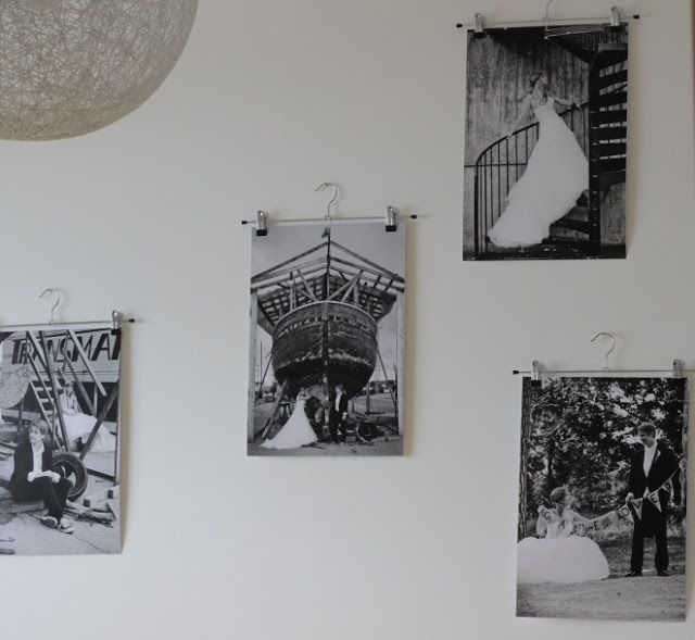 Our wedding portraits hanging on bedroom wall