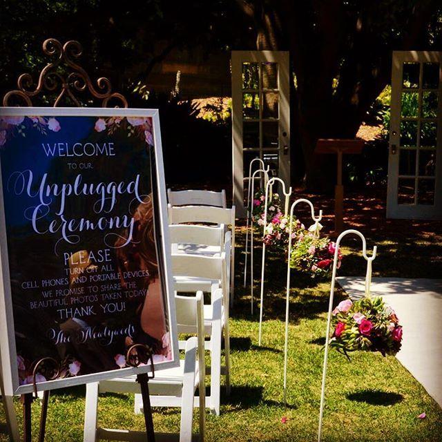 #kirkbride #sydneycollegeofthearts #weddingceremony #outdoorceremony #succulentwedding #succulentkissingball #shepherdshooks #floralstyling #weddingstyling #easel by @countryside_love