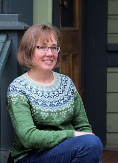 This colorwork pullover is worked in the round from the top down with 4 colors of fingering weight yarn.