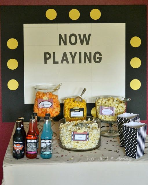 movie party popcorn bar/// marquee backdrop: draw lines, add sticker letters onto sheet of posterboard, mounted to black foamcore and add yellow cardstock circles