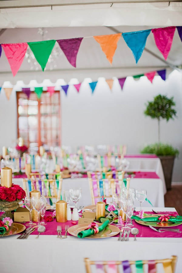 Love the ribbons on the seats and coloured bunting! A Multi-Coloured South African Wedding: Mark & Manilla · Wedding · Rock n Roll Bride