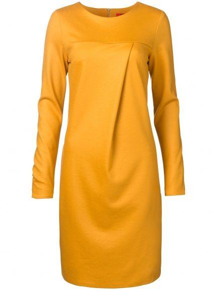 Oilily Deze asymmetrische jurk is gemaakt van een fijne mix van wol, polyester en elasthan. Dit maakt de jurk heerlijk zacht. In warm okergeel.