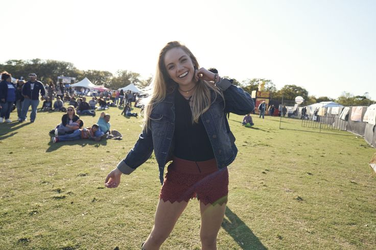 Danielle Bradbery dancing in the festival sun.